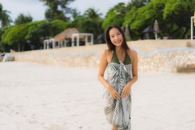 Portrait beautiful asian women happy smile relax on the tropical beach sea ocean