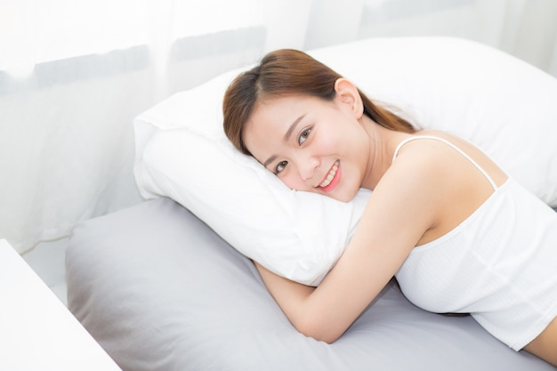 Portrait beautiful asian young woman sleep lying in bed