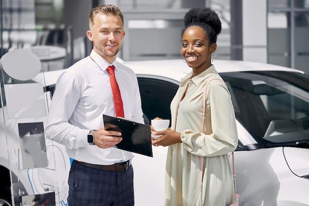 Portrait of beautiful black customer woman and caucasian sales agent