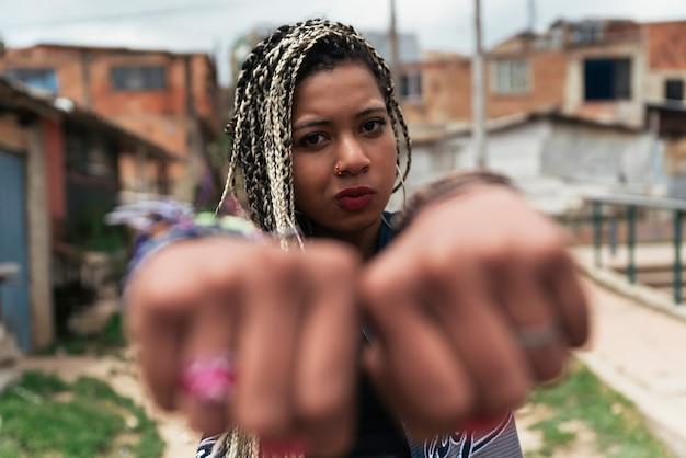 Portrait of beautiful black woman in her neighborhood. slum concept.