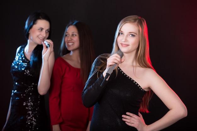 Portrait of beautiful blond girl singer