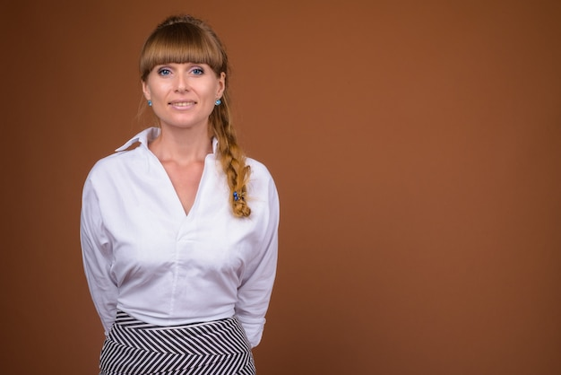 Portrait of beautiful blonde businesswoman with braided hair
