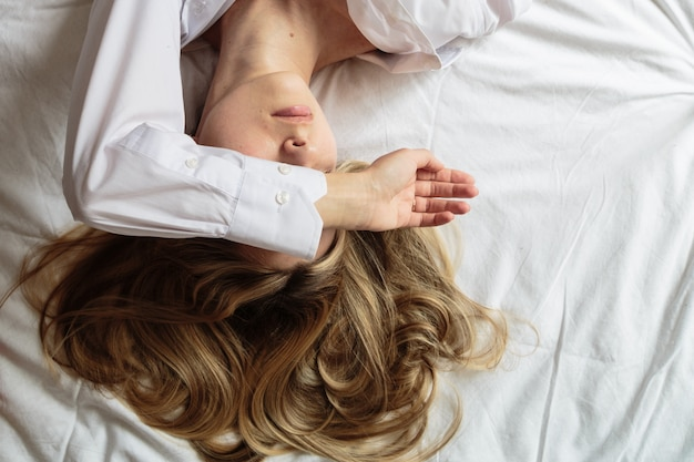 Portrait beautiful blonde woman in the bed