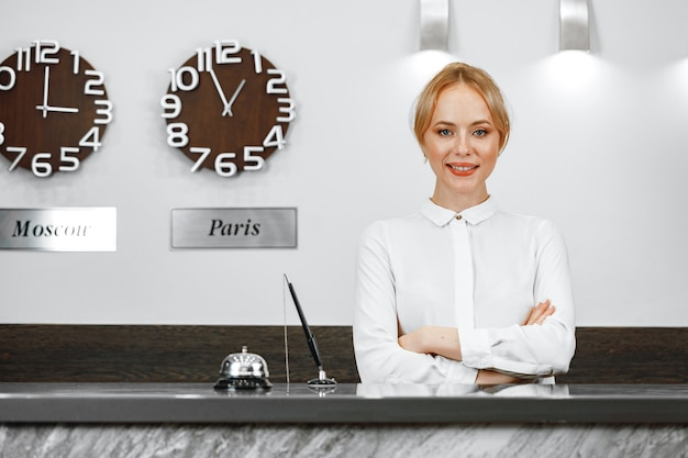 Portrait of beautiful blonde woman hotel receptionist close up