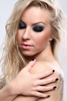 Portrait of beautiful blonde woman with dark makeup