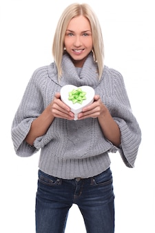 Portrait of beautiful blonde woman with heart-shaped gift box