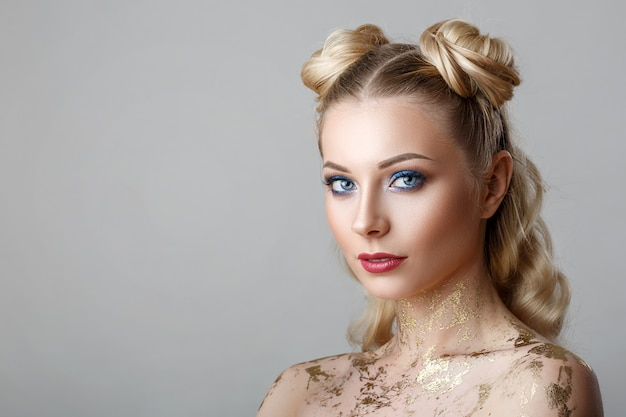 Portrait of beautiful blonde woman with makeup beauty photoshoot on background.