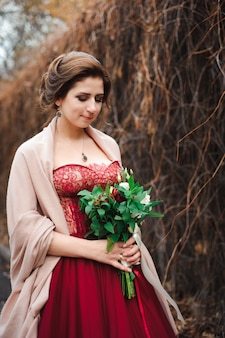 Portrait of a beautiful bride in a red dress