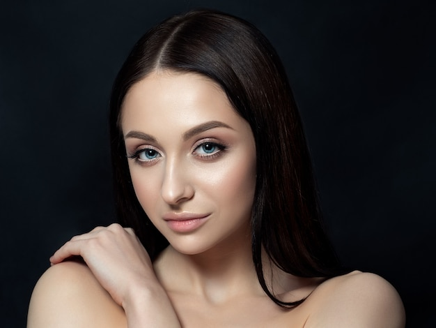 Portrait of beautiful brunet woman with nude makeup. luxury skincare concept.