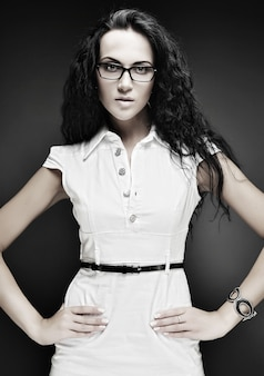 Portrait of beautiful brunette girl in glasses
