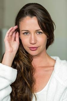 Portrait of beautiful brunette woman in bathrobe