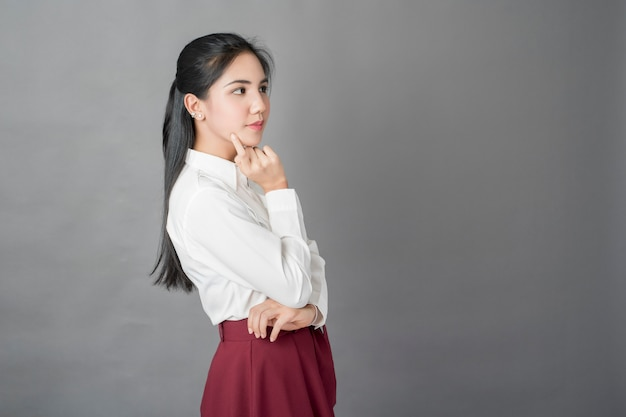 Portrait of beautiful  business woman on grey background, studio shot