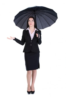 Portrait of a beautiful business woman holding a umbrella.