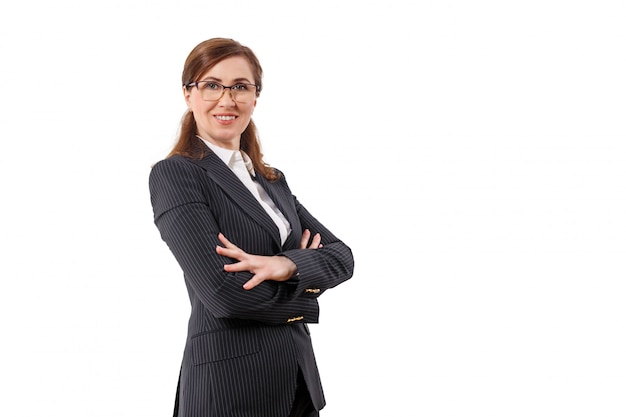 Portrait of a beautiful businesswoman 50 ears old in crossed arms pose isolated on white.