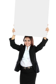 Portrait of beautiful businesswoman holding blank poster over her head