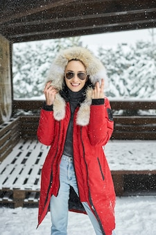 A portrait of beautiful caucasian girl in glases outdoor in snowy winter