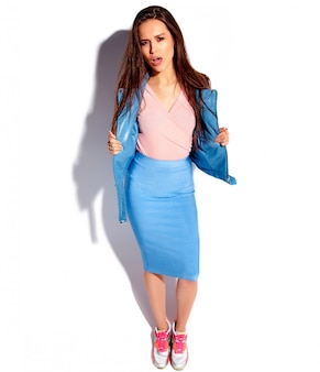 Portrait of beautiful caucasian smiling brunette woman model in bright pink and blue summer stylish clothes