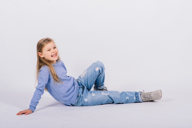 Portrait of a beautiful and confident girl showing thumbs up isolated