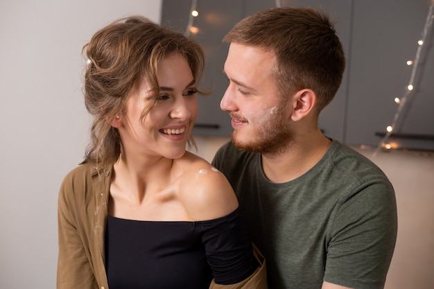 Portrait of beautiful couple in kitchen during breakfast time