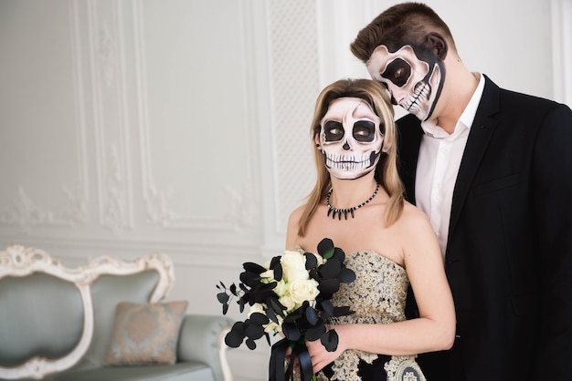 Portrait of a beautiful couple in medieval costumes with vampire style make-up