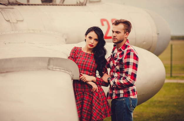 Portrait of a beautiful couple near the aircraft