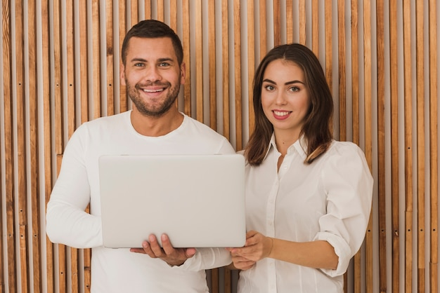 Portrait of beautiful couple with a laptop
