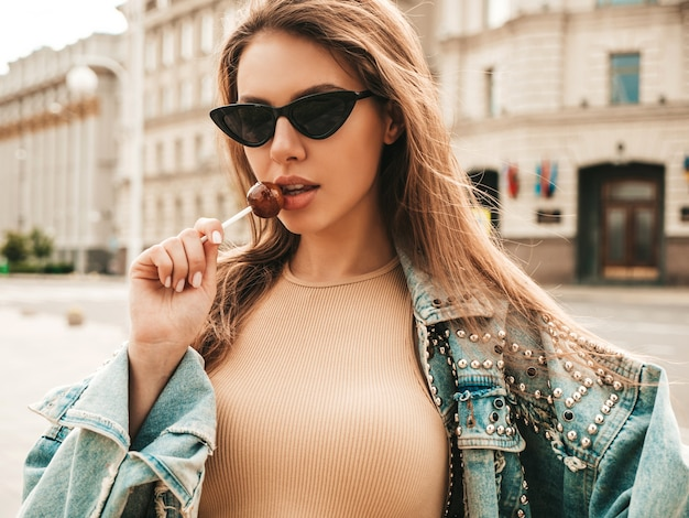 Portrait of beautiful cute model in summer hipster jeans jacket clothes