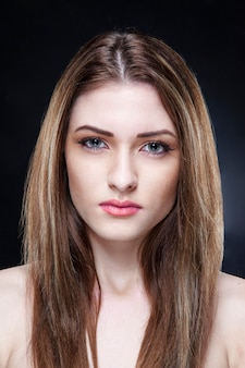 Portrait of a beautiful elegant female model with bare shoulders with makeup