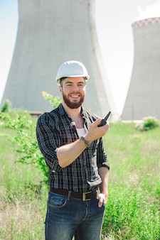 Portrait of a beautiful engineer at work with the phone.