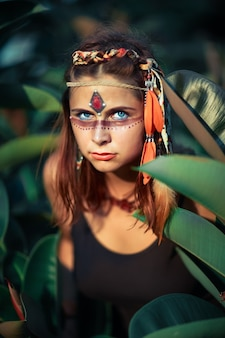 Portrait of a beautiful ethnic woman posing outdoor. creative makeup