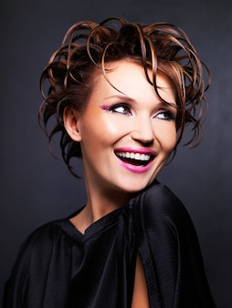 Portrait of the beautiful expressive woman with fashion hairstyle posing.