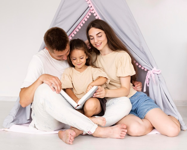 Portrait of beautiful family in a tent