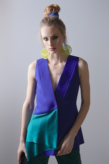 Portrait of beautiful fashion model in sleeveless jacket and trousers.