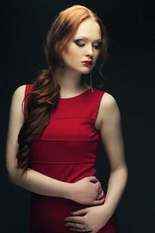 Portrait of beautiful fashionable woman on dark