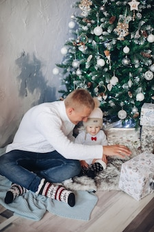 Portrait of beautiful father with his little son in christmas atmosphere