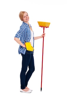 Portrait of beautiful female cleaner with broom