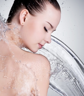 Portrait of beautiful female face with clean water
