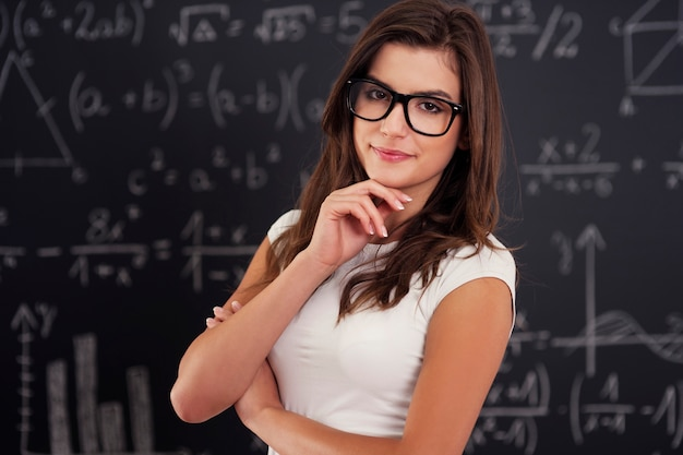 Portrait of beautiful female student wearing on glasses