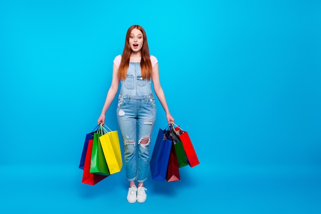 Portrait of beautiful ginger woman with shopping bags