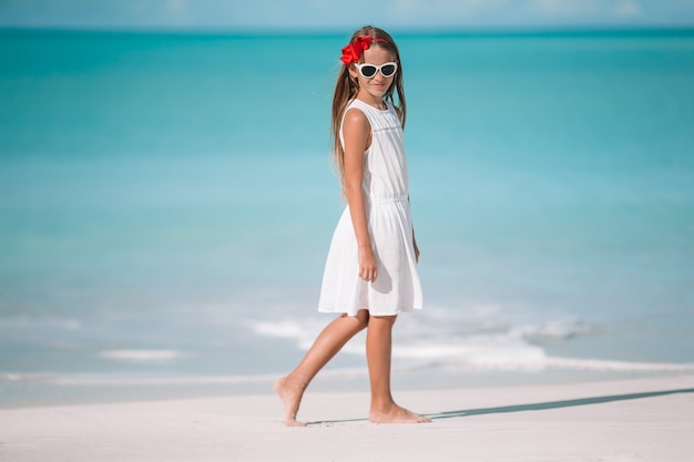 Portrait of beautiful girl on the beach dancing