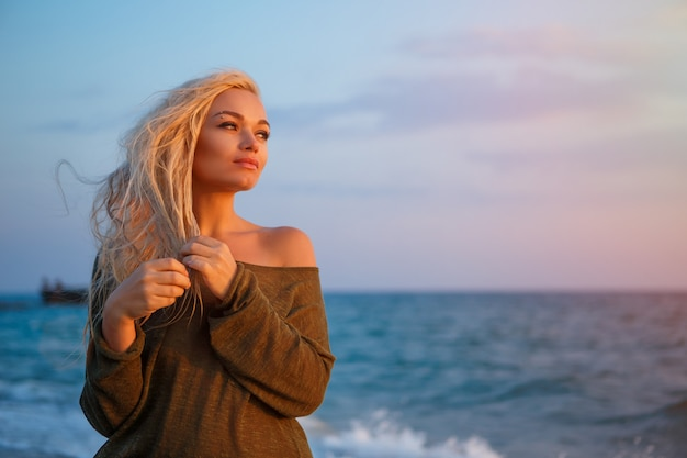Portrait of a beautiful girl on the beach at sunset.