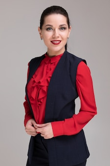 Portrait of a beautiful girl in bright business clothes isolated