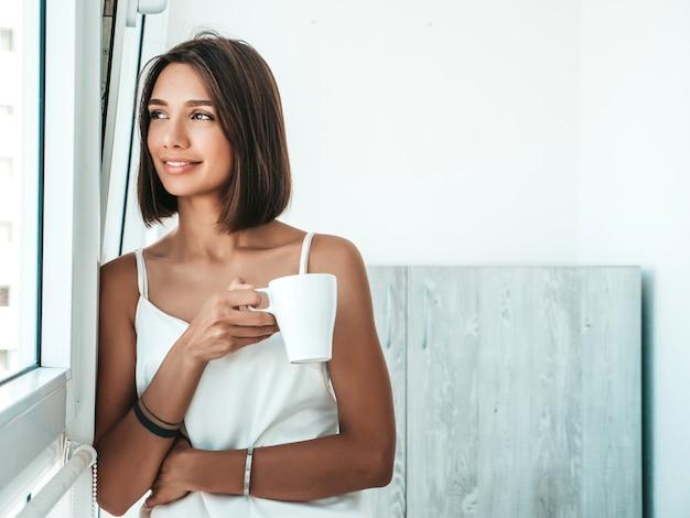 Portrait of beautiful girl dressed in white pajamas