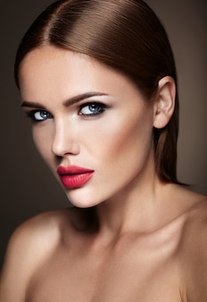 Portrait of beautiful girl model with evening makeup and romantic hairstyle. red lips