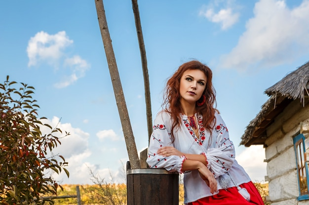 Portrait of a beautiful girl in the national slavic costume.