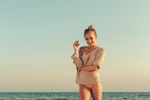 Portrait of a beautiful girl at the sea