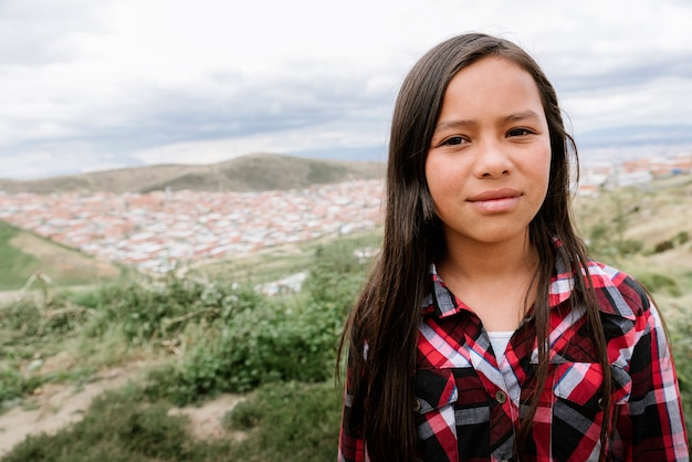 Portrait of beautiful girl in shanty town. poor infant concept.