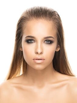 Portrait of beautiful girl on white background. smoky eyes. hi-end retouch