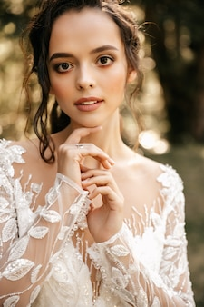 Portrait of a beautiful girl in a white dress