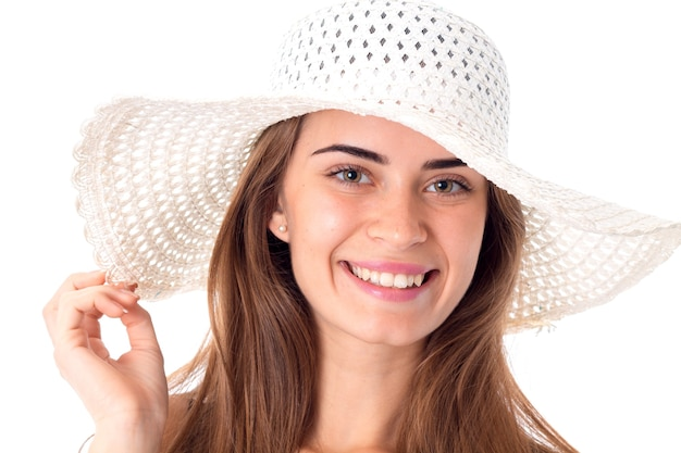 Portrait of beautiful girl in white hat with wide brim isolated on white background
